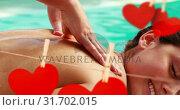 Купить «Massage on swimming pool side with cute red paper hearts for valentine day 4k», видеоролик № 31702015, снято 6 ноября 2018 г. (c) Wavebreak Media / Фотобанк Лори