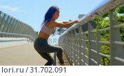 Купить «Beautiful young dancer practicing dance on the bridge in the city 4k», видеоролик № 31702091, снято 26 сентября 2018 г. (c) Wavebreak Media / Фотобанк Лори