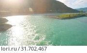 Купить «Low altitude flight over fresh fast mountain river with rocks at sunny summer morning.», видеоролик № 31702467, снято 29 марта 2019 г. (c) Александр Маркин / Фотобанк Лори