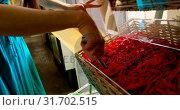 Купить «Close-up of woman packing snacks in supermarket 4k», видеоролик № 31702515, снято 13 сентября 2018 г. (c) Wavebreak Media / Фотобанк Лори