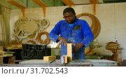 Купить «Male working on wooden block in workshop 4k», видеоролик № 31702543, снято 27 сентября 2018 г. (c) Wavebreak Media / Фотобанк Лори