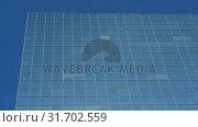 Купить «Modern glass buildings in the city 4k», видеоролик № 31702559, снято 24 сентября 2018 г. (c) Wavebreak Media / Фотобанк Лори