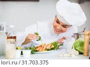 Купить «Professional chef decorating baked rainbow», фото № 31703375, снято 4 июля 2020 г. (c) Яков Филимонов / Фотобанк Лори