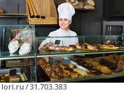 Купить «Glad female cooks demonstrating and selling to the customer pastry», фото № 31703383, снято 22 июля 2019 г. (c) Яков Филимонов / Фотобанк Лори