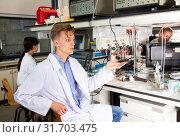 Купить «male scientist engaged in research in chemical laboratory», фото № 31703475, снято 28 мая 2019 г. (c) Яков Филимонов / Фотобанк Лори