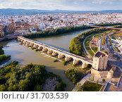 Mosque-Cathedral of Cordoba and Roman Bridge over the Guadalquivir (2019 год). Стоковое фото, фотограф Яков Филимонов / Фотобанк Лори