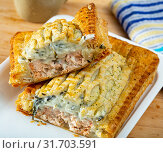 Купить «Delicious salmon puff pastry pie closeup», фото № 31703591, снято 18 мая 2019 г. (c) Яков Филимонов / Фотобанк Лори