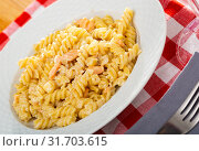 Купить «Close up of tasty warm pasta with smoked salmon at plate on table», фото № 31703615, снято 23 июля 2019 г. (c) Яков Филимонов / Фотобанк Лори