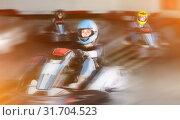 Купить «Pretty woman driving sport car in a circuit lap», фото № 31704523, снято 22 октября 2019 г. (c) Яков Филимонов / Фотобанк Лори