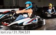 Купить «Woman driving sport car for karting in a circuit lap in sport club», фото № 31704531, снято 22 октября 2019 г. (c) Яков Филимонов / Фотобанк Лори