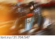 Купить «active woman in helmet driving car for karting with other people», фото № 31704547, снято 18 марта 2019 г. (c) Яков Филимонов / Фотобанк Лори