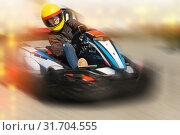 Купить «Girl driving kart at racing track outdoors», фото № 31704555, снято 18 марта 2019 г. (c) Яков Филимонов / Фотобанк Лори