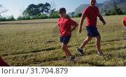 Купить «Male trainer training kids in the boot camp on a sunny day 4k», видеоролик № 31704879, снято 16 марта 2017 г. (c) Wavebreak Media / Фотобанк Лори