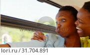 Купить «Twin sisters taking selfie with mobile phone in the bus 4k», видеоролик № 31704891, снято 6 мая 2018 г. (c) Wavebreak Media / Фотобанк Лори