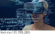 Купить «Woman wearing virtual goggles», видеоролик № 31705283, снято 27 марта 2019 г. (c) Wavebreak Media / Фотобанк Лори