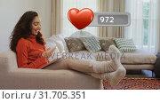 Купить «Woman relaxing on a couch while browsing on her phone», видеоролик № 31705351, снято 5 апреля 2019 г. (c) Wavebreak Media / Фотобанк Лори