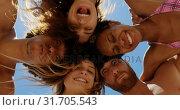 Купить «Young friends forming huddle at beach 4k», видеоролик № 31705543, снято 9 января 2019 г. (c) Wavebreak Media / Фотобанк Лори