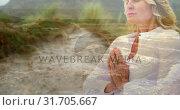 Купить «Woman meditating near the beach 4k», видеоролик № 31705667, снято 17 апреля 2019 г. (c) Wavebreak Media / Фотобанк Лори