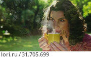 Woman drinking coffee outdoors. Стоковое видео, агентство Wavebreak Media / Фотобанк Лори