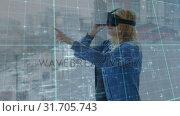 Купить «Woman typing in the air while wearing a virtual reality headset», видеоролик № 31705743, снято 25 апреля 2019 г. (c) Wavebreak Media / Фотобанк Лори