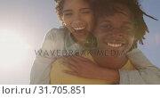 Купить «Man giving piggyback ride to woman on the beach 4k», видеоролик № 31705851, снято 8 февраля 2019 г. (c) Wavebreak Media / Фотобанк Лори