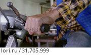 Купить «Male mechanic repairing scooter in repair garage 4k», видеоролик № 31705999, снято 10 февраля 2019 г. (c) Wavebreak Media / Фотобанк Лори