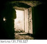 Ajlun district. Stone door at M'keis. Showing basalt door carved to represent wooden panelling. 1920, Jordan, Um Qays (2018 год). Редакционное фото, фотограф © Liszt Collection / age Fotostock / Фотобанк Лори