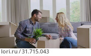 Купить «Couple unpacking cardboard box in new home 4k», видеоролик № 31715043, снято 12 марта 2019 г. (c) Wavebreak Media / Фотобанк Лори
