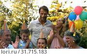 Купить «Family celebrating a birthday party», видеоролик № 31715183, снято 21 июня 2019 г. (c) Wavebreak Media / Фотобанк Лори