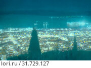 Along the Mediterranean coast, southward. Haifa at night from Mt. Carmel. 1950, Israel, Haifa (2018 год). Редакционное фото, фотограф © Liszt Collection / age Fotostock / Фотобанк Лори
