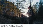 Купить «Two young women travelers standing and pulling their hands up - mountains of Dolomites», видеоролик № 31746227, снято 10 июля 2020 г. (c) Константин Шишкин / Фотобанк Лори