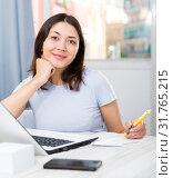 Купить «Young girl student with laptop and papers working at home», фото № 31765215, снято 18 апреля 2018 г. (c) Яков Филимонов / Фотобанк Лори