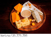 Купить «Various cheeses with nuts and fruits on wooden plate», фото № 31771791, снято 13 ноября 2019 г. (c) easy Fotostock / Фотобанк Лори