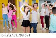 Купить «Tweens practicing jive in dance class», фото № 31798691, снято 3 марта 2018 г. (c) Яков Филимонов / Фотобанк Лори