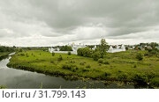Big white fenced Christian church in the village - Suzdal, Russia. Стоковое видео, видеограф Константин Шишкин / Фотобанк Лори