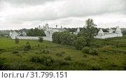 Big white Christian church with fence in the village - Suzdal, Russia. Стоковое видео, видеограф Константин Шишкин / Фотобанк Лори