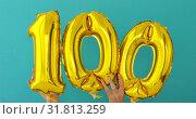 Купить «Gold foil number 100 celebration balloon», видеоролик № 31813259, снято 24 июля 2019 г. (c) Ekaterina Demidova / Фотобанк Лори