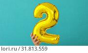 Купить «Gold foil number 2 celebration balloon», видеоролик № 31813559, снято 24 июля 2019 г. (c) Ekaterina Demidova / Фотобанк Лори