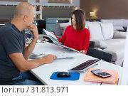 Купить «Female client consulting with shopper about choosing furniture in shop», фото № 31813971, снято 29 октября 2018 г. (c) Яков Филимонов / Фотобанк Лори