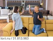 Купить «Couple having fun in furniture shop», фото № 31813983, снято 29 октября 2018 г. (c) Яков Филимонов / Фотобанк Лори