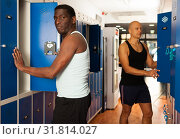 Купить «Two athletes in the locker room after training», фото № 31814027, снято 28 января 2019 г. (c) Яков Филимонов / Фотобанк Лори