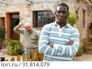 Купить «Man ignoring neighbor after quarrel», фото № 31814079, снято 15 декабря 2018 г. (c) Яков Филимонов / Фотобанк Лори
