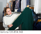 Купить «Woman shopping in outerwear clothing boutique», фото № 31814143, снято 6 декабря 2018 г. (c) Яков Филимонов / Фотобанк Лори