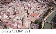 Купить «Aerial panoramic view of Murcia cityscape with bell tower of Cathedral Church of Saint Mary, Spain», видеоролик № 31841891, снято 17 апреля 2019 г. (c) Яков Филимонов / Фотобанк Лори