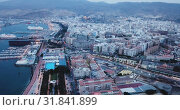 Купить «Aerial panorama of Almeria cityscape and vessels in harbor, Andalusia, Spain», видеоролик № 31841899, снято 22 мая 2019 г. (c) Яков Филимонов / Фотобанк Лори