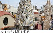 Купить «Magical rooftop of Palau Guell with chimneys and central spire designed by architect Antoni Gaudi», видеоролик № 31842419, снято 2 сентября 2018 г. (c) Яков Филимонов / Фотобанк Лори