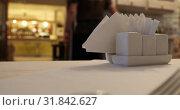Купить «The waiter put the menu on the table and went into another room», видеоролик № 31842627, снято 12 марта 2019 г. (c) Aleksandr Sulimov / Фотобанк Лори