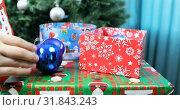Купить «Blue Christmas balls from holiday boxes», видеоролик № 31843243, снято 25 ноября 2018 г. (c) Aleksandr Sulimov / Фотобанк Лори