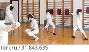 Купить «Friendly group practicing fencing techniques», фото № 31843635, снято 30 мая 2018 г. (c) Яков Филимонов / Фотобанк Лори