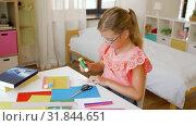 Купить «creative girl making greeting card at home», видеоролик № 31844651, снято 21 июля 2019 г. (c) Syda Productions / Фотобанк Лори
